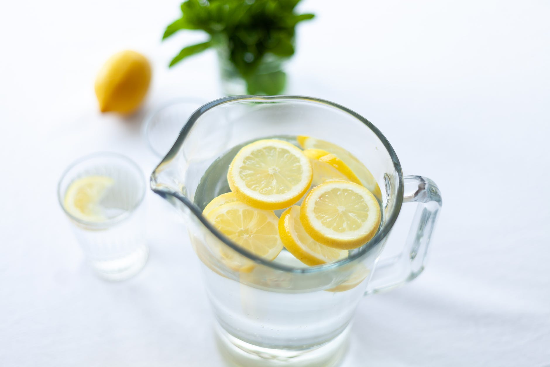 sliced lemon fruit in glass picher